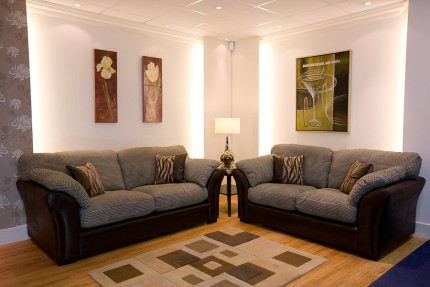Room set up with brown and grey fabric sofas