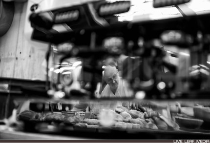 Bakers reflection in coffee machine