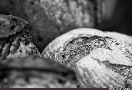 Black and white photo of bread with flour