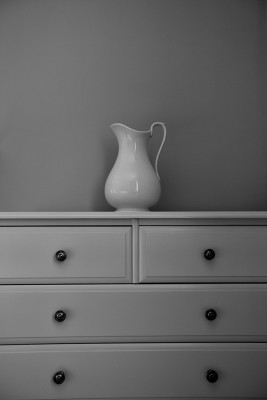 Chest of draws with milk jug