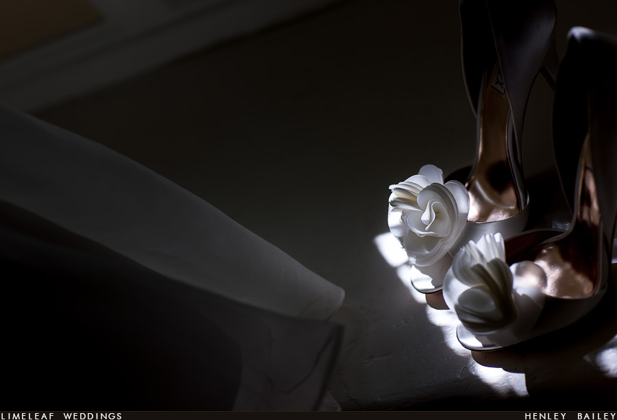 The brides shoes are seen in a patch of sunlight