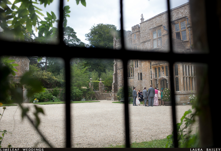 Guests are seen congregating outside Brympton House from the window of Castle House