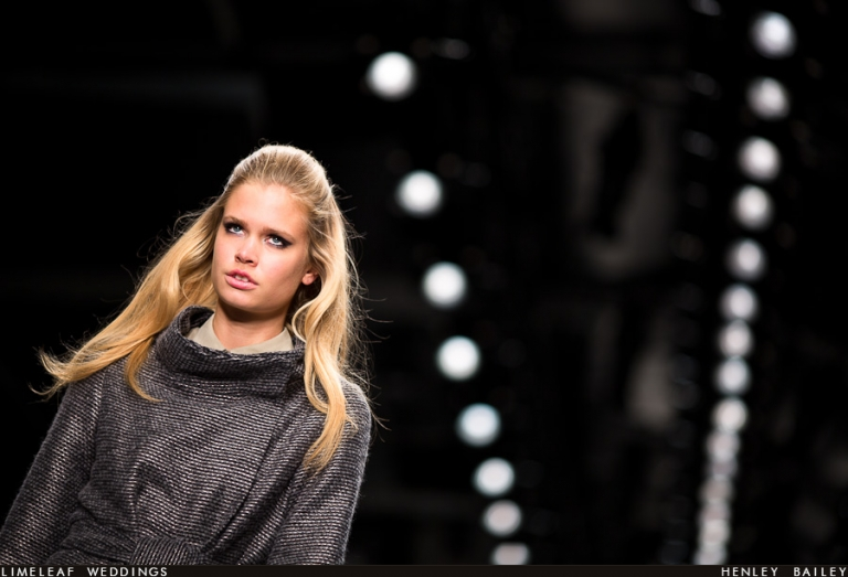 A model in a grey tweed coat on the catwalk at Fashion week