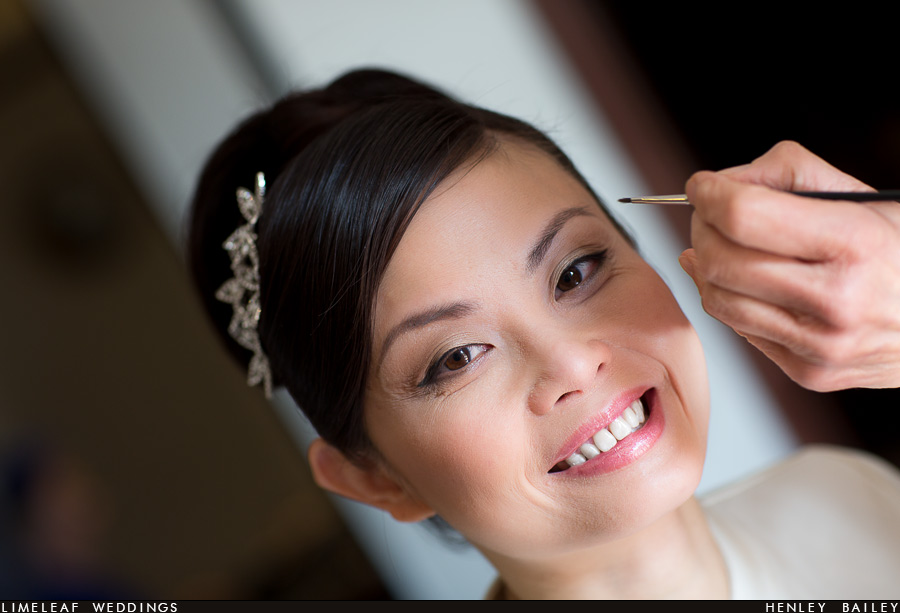 Ashley the bride smiling during makeup