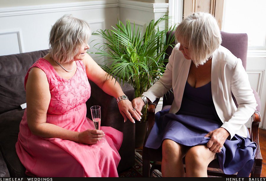 Mother of the bride and her sister chat and compare wedding rings