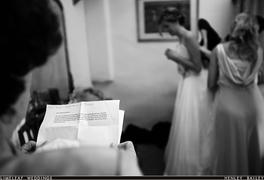 Mother reading out letter to bride
