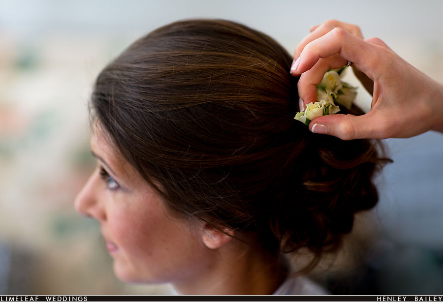 Bride has flower put in hair