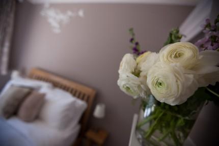 Fresh flowers in guest bedroom