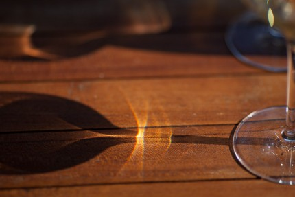 Wine glass refraction on table