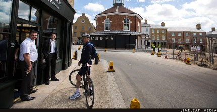 Cyclist in front of Butter Market Bakery
