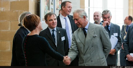 Prince Charles shakes Lucy's hand